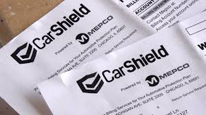 A photo of CarShield MEPCO contracts. CarShield MEPCO is a partnership between the two companies.